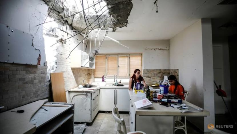 Kitchen smashed and sirens sounding, Israeli family holds on after rocket hits
