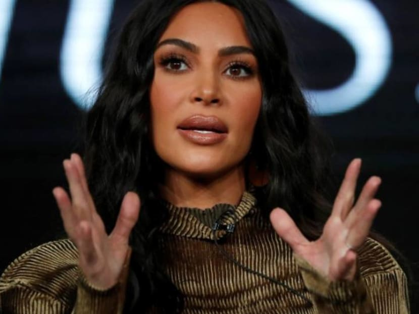 How is Kim Kardashian greeting other people now that she can't shake hands?