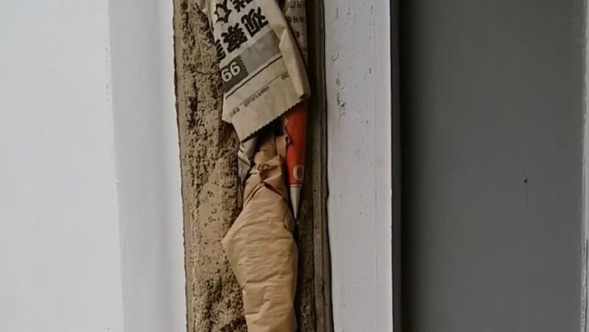 HDB investigating after newspaper found stuffed within walls of flat