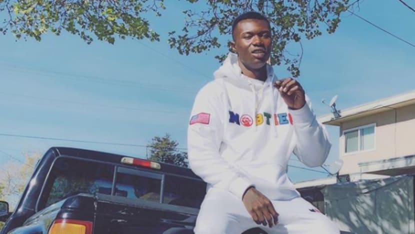 US police under scrutiny after rapper shot dead in car