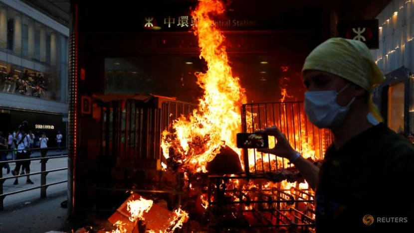 Hong Kong police fire tear gas after clashes erupt as protesters start street fires