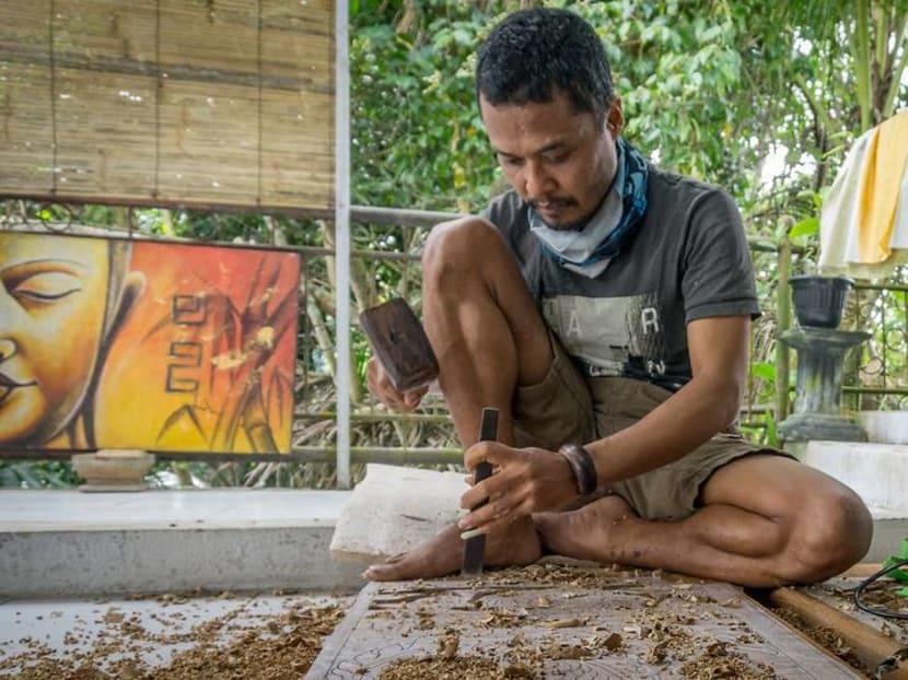 As tourist flow stops, Bali's craftsmen struggle to market their work online