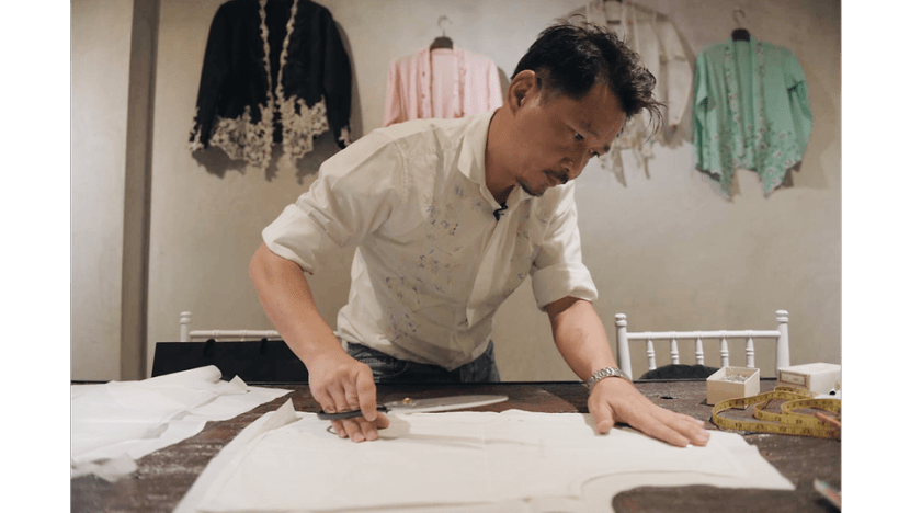Defiantly, he weaves life into a dying Peranakan craft