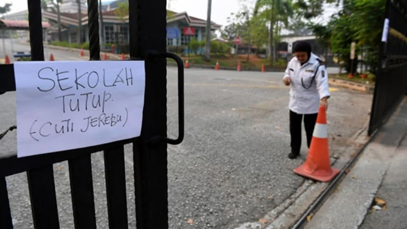 Nearly 1,500 schools across Malaysia ordered to close as haze worsens