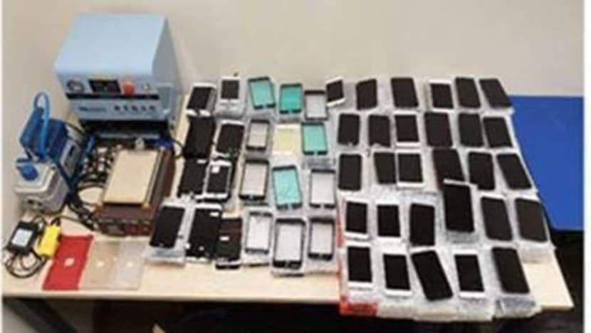 3 arrested for importing counterfeit mobile phones, components worth S$290,000