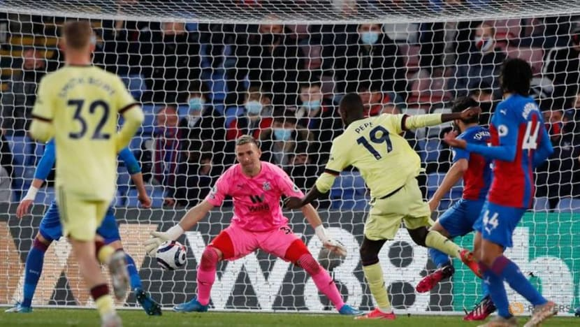 Football: Arsenal stage late show to see off Palace