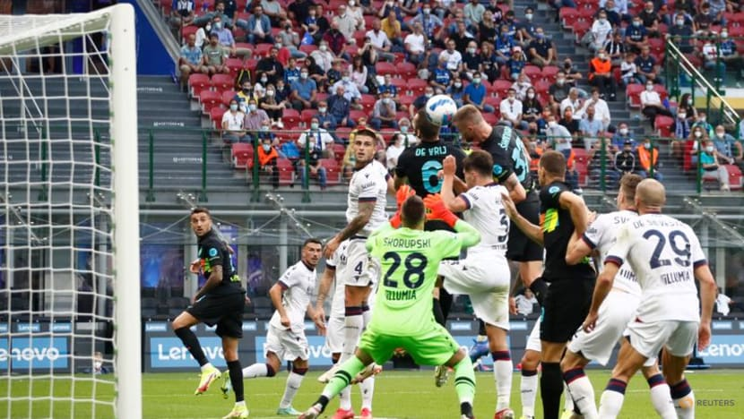 Football: Champions Inter back on top after hitting Bologna for six
