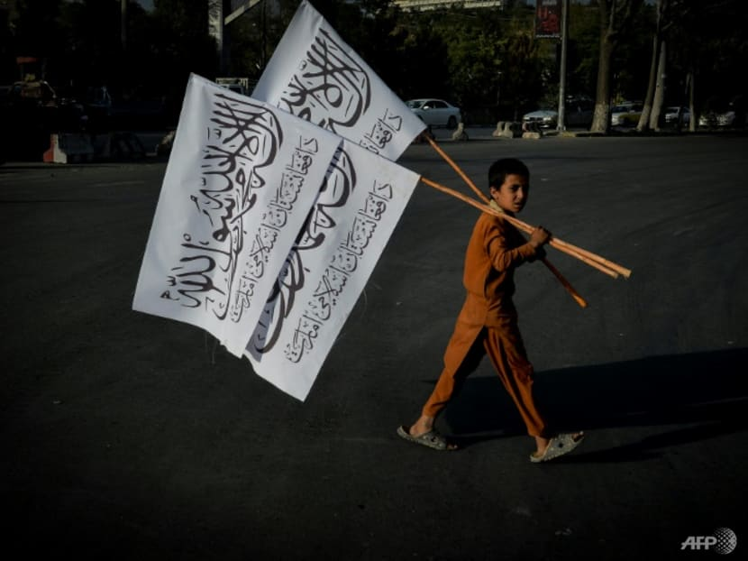 Taliban flags proliferate as Afghan tricolour becomes resistance symbol