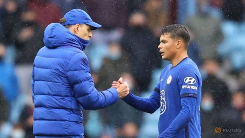 Football: Chelsea squeeze into Champions League despite defeat at Villa