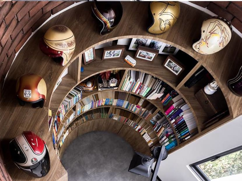 This family's cafe-inspired HDB maisonette has a huge home library for their books