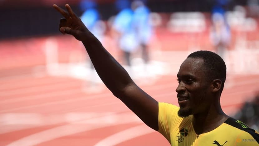 Olympics-Athletics-Crouser sets shot record, Parchment beats hurdles world champion