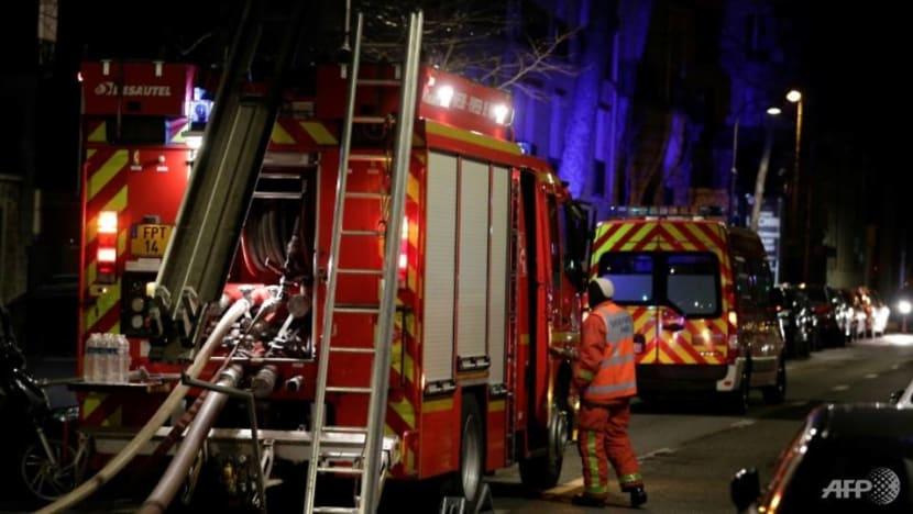Woman held after blaze in Paris kills 10, injures 30