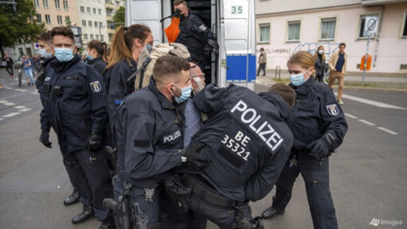 Police, protesters clash as thousands march against COVID-19 curbs in Berlin