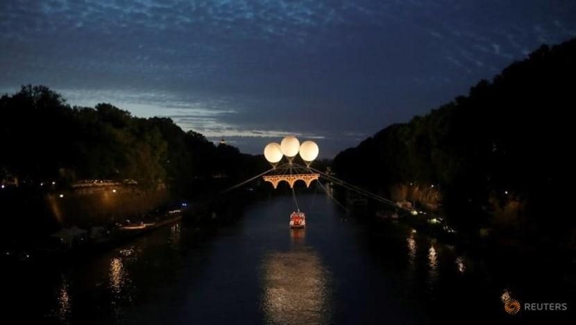 Michelangelo-inspired cardboard bridge floats above Rome's Tiber river