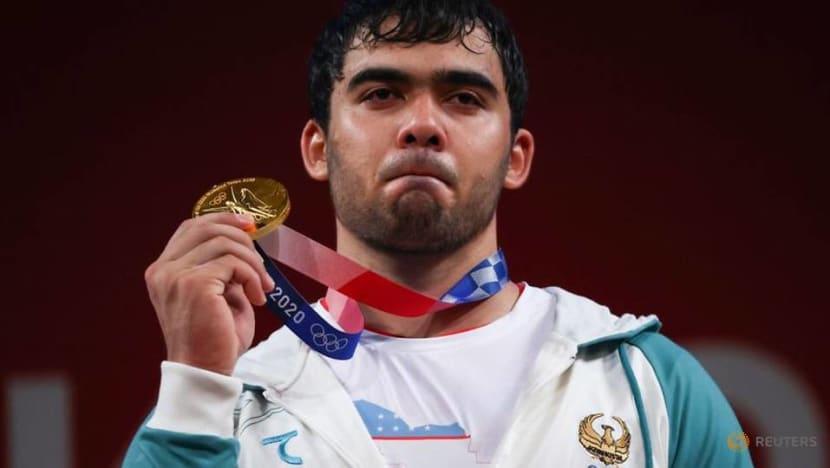 Olympics-Weightlifting-Djuraev beat Armenia's record holder to win men's 109kg