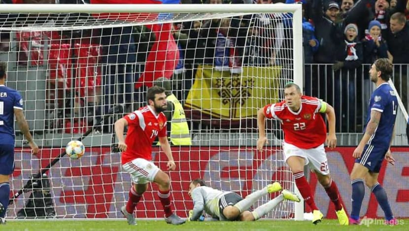Football: Russia on brink of Euro 2020 after Dzyuba downs Scotland