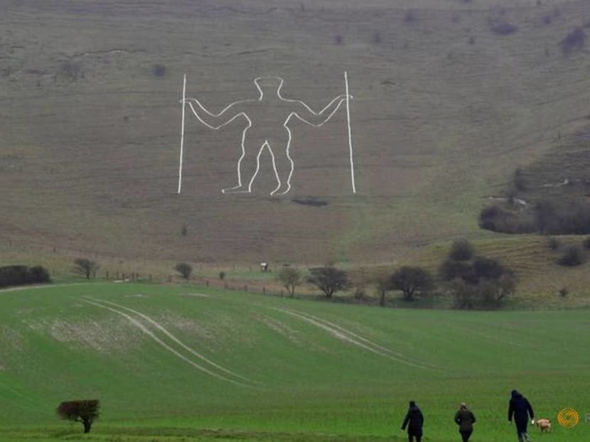COVID face mask painted on giant English chalk figure