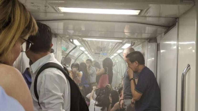 White smoke in train at Raffles Place MRT due to leaking air-conditioning compressor