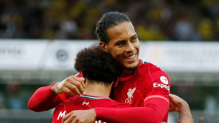 Soccer-Liverpool return 'emotional and tough' after prolonged absence, says Van Dijk
