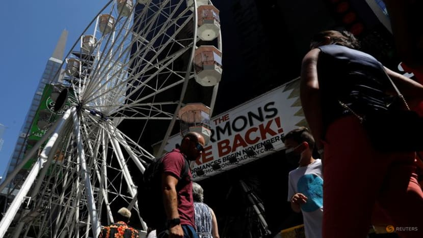 A Ferris wheel lifts spirits in New York's Times Square