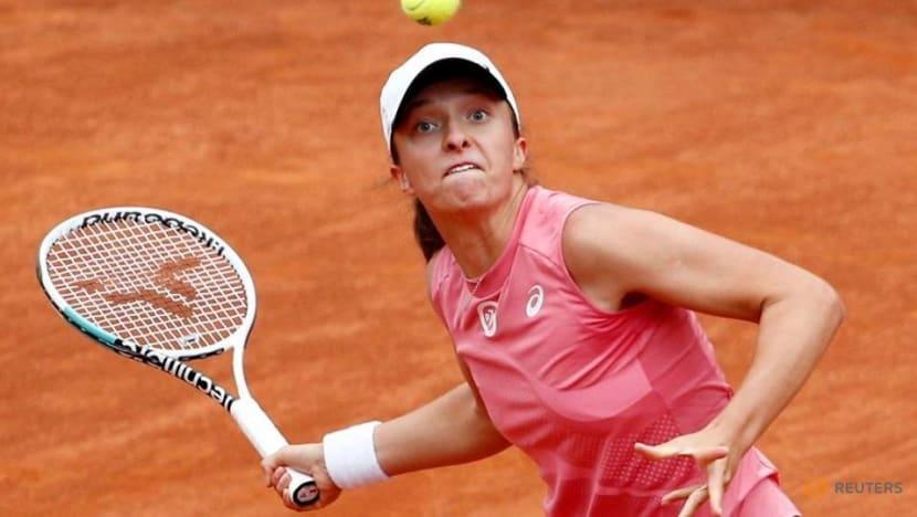 Tennis-Proud Swiatek adds top-10 ranking to her resume