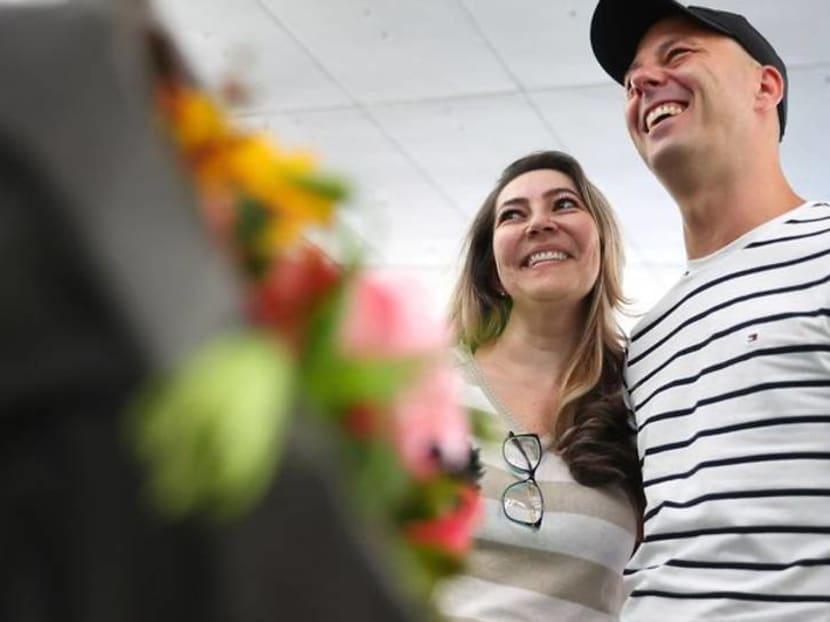 German-Brazilian couple hug again after coronavirus separation