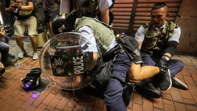 LegCo members stood between Hong Kong protesters and riot police during violent clashes in Mong Kok