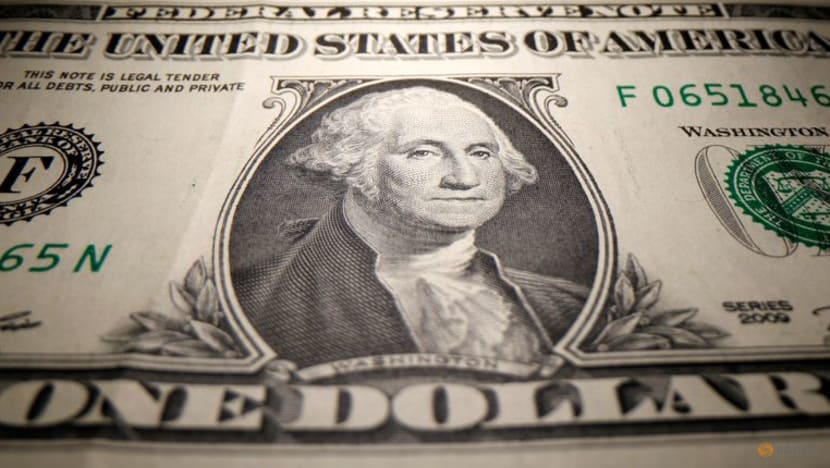 Dollar holds firm as Fed hawks urge early taper ahead of Powell's speech