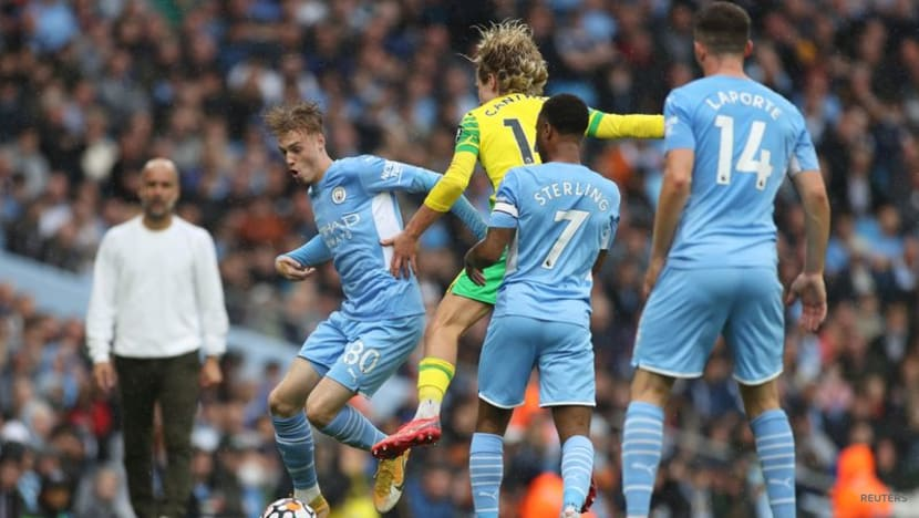 Soccer-Grealish on target as Man City put five past hapless Norwich