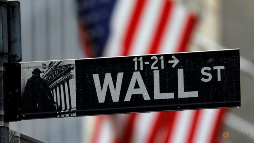 Wall Street drops as stimulus rally cools, Tesla at record high