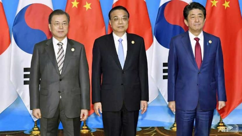 China hosts Japan, South Korea with eyes on nuclear North