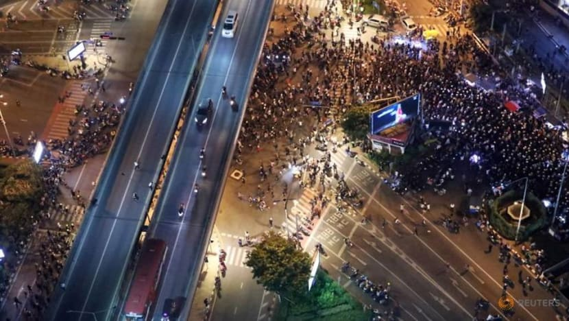 Thai protesters, 'human beings, not dust', march in challenge to king