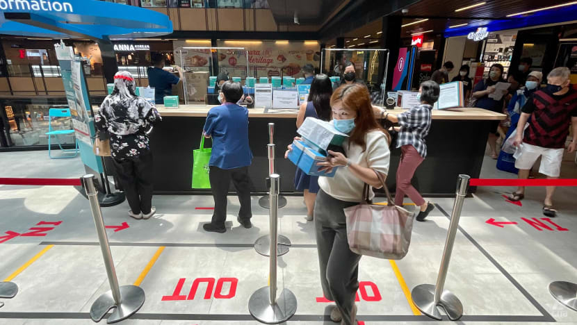 Free mask collection kicks off, some malls see small crowds around collection points