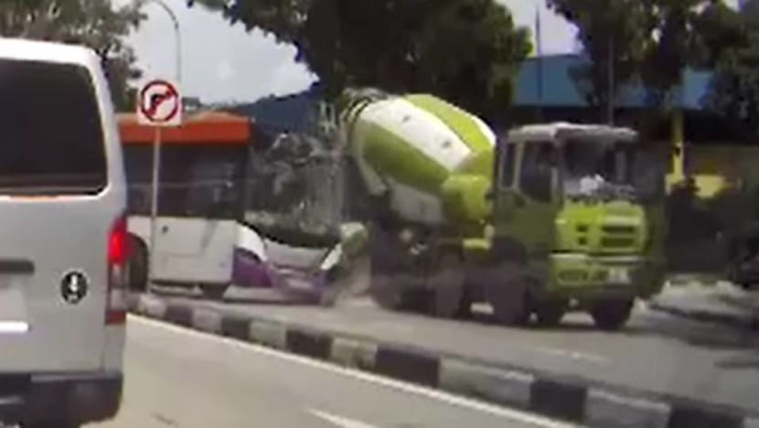 SBS Transit bus driver, 2 passengers taken to hospital after accident with cement mixer