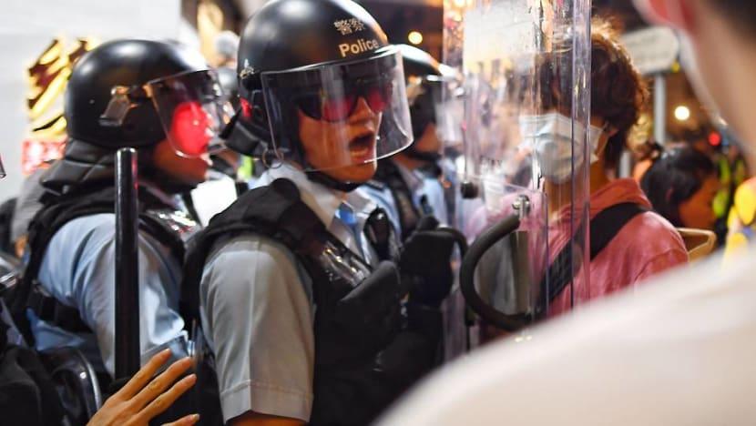 Hong Kong police fire tear gas at demonstrators in Sham Shui Po