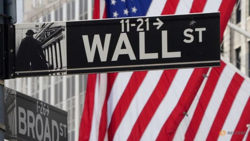 Major US indices rise, tech retreats after Fed policy shift