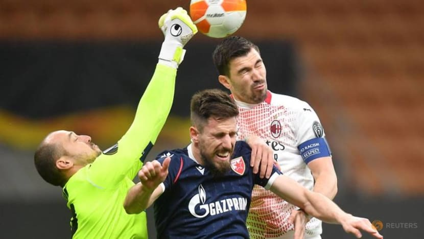 Football: Milan limp through on away goals after draw with Red Star