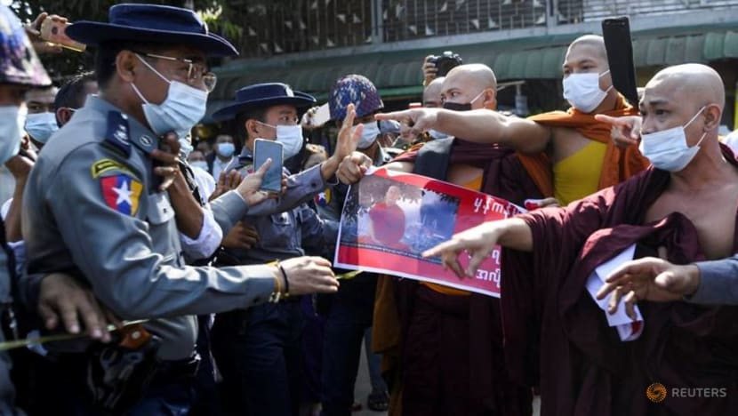Myanmar police scuffle with nationalist monk's followers