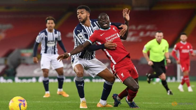 Liverpool miss chance to stretch lead, Tottenham held at Wolves