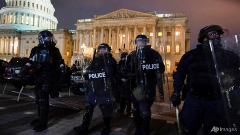US Congress reconvenes to certify Biden win after protesters invaded Capitol