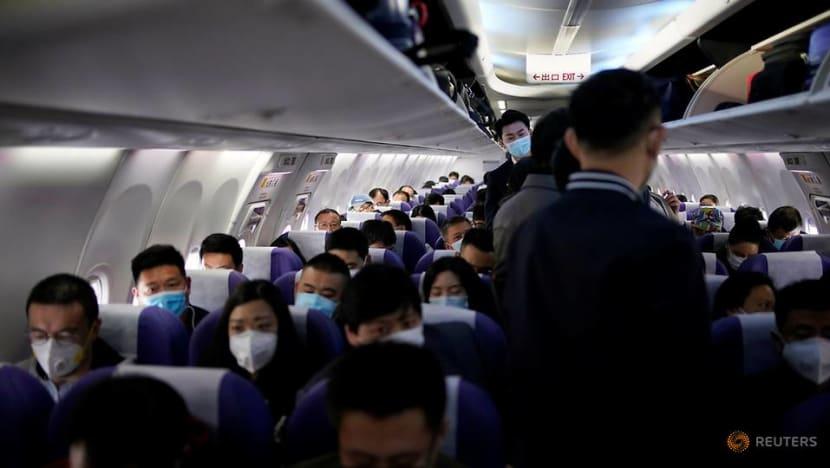 China cuts international flights, bars foreign residents