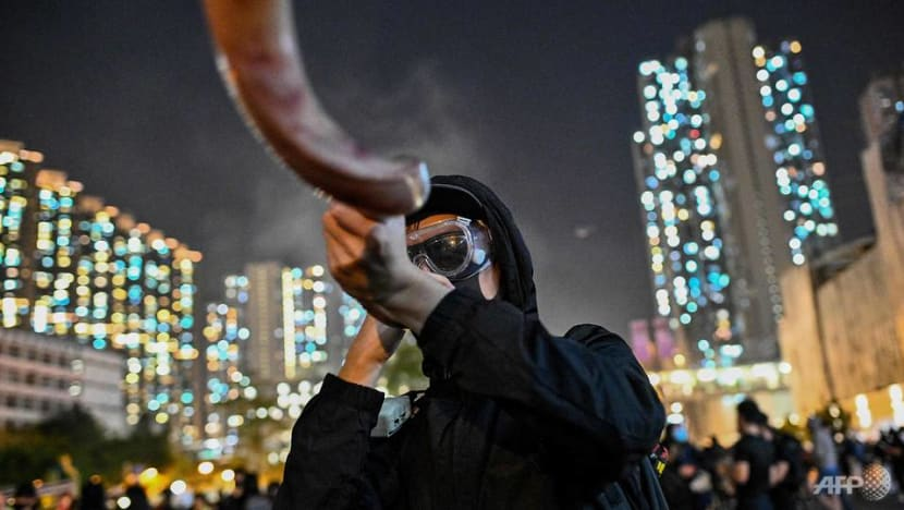 Hong Kong vigils for dead student turn to street clashes
