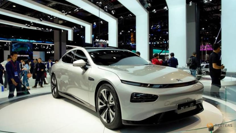 Chinese EV maker Xpeng shares close flat in HK debut as it eyes global rollout