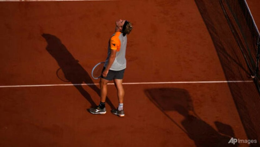 Tennis: Fokina battles past Delbonis to reach French Open quarters