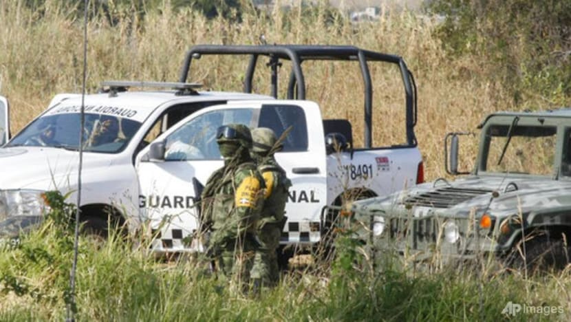 Searchers find 59 bodies in Mexico mass graves, dig for more