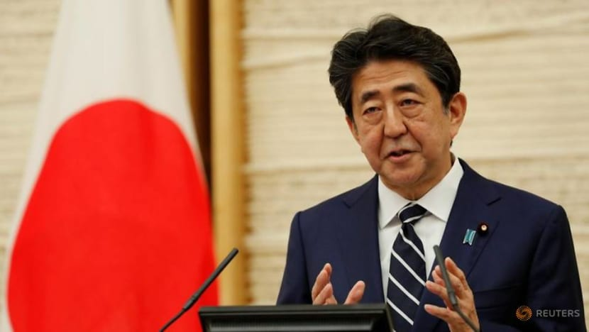 Japan PM vows to back corporate financing with second extra budget