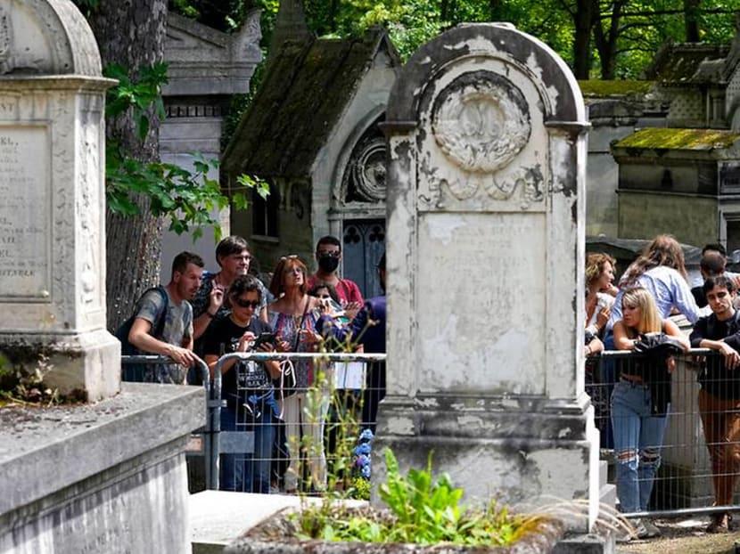 Fans honour The Doors' frontman Jim Morrison in Paris 50 years after his death