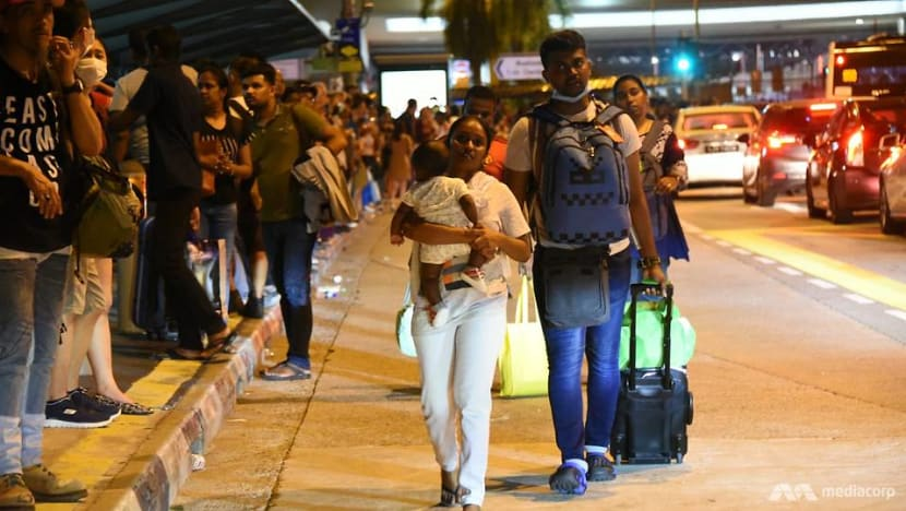 In pictures: Crowds, traffic jams as last JB commuters enter Singapore ahead of Malaysia's COVID-19 travel restrictions