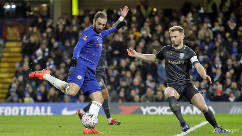 Football: Willian double as FA Cup holders Chelsea beat Wednesday on Higuain debut