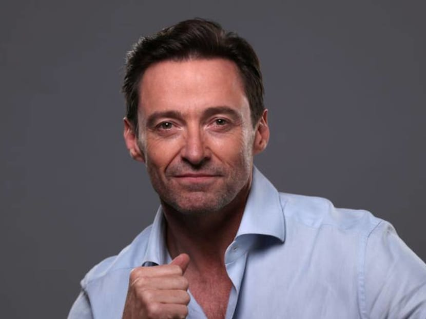 Hugh Jackman turns barista for a day, serves surprised fans coffee and autographs